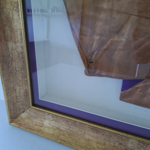 Conservation Framing for Jockey Silks