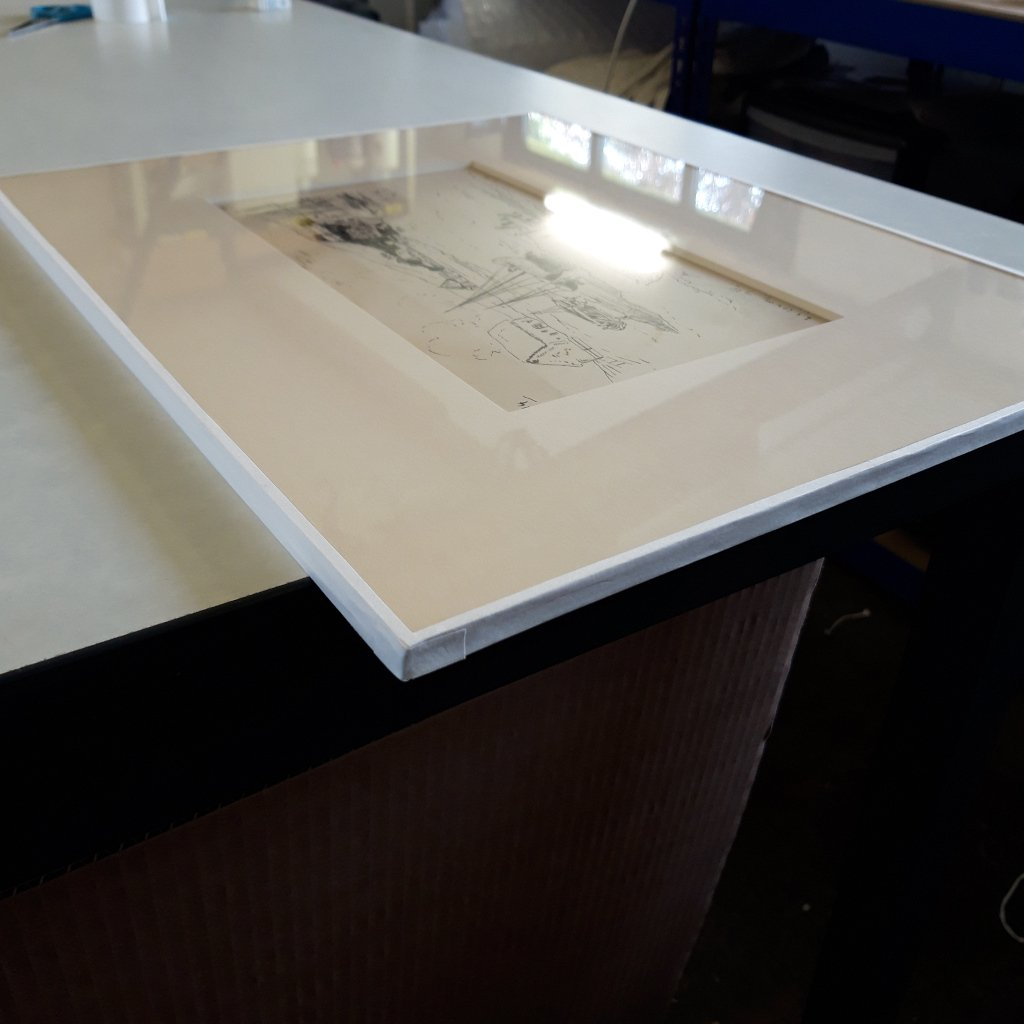 Conservation Framing with the mount package taped to the glass for extra protection for this L S Lowry drawing