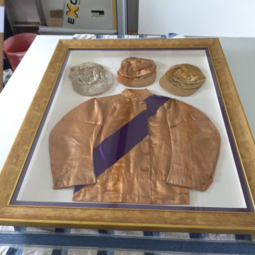 Conservation framing for these almost century old Jockey Silks