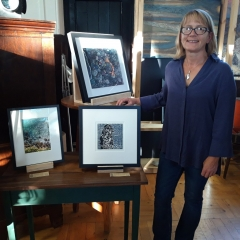 Framer Jo Ronald with the Art at the Hall prizewinners framed pictures sponsored by Pure Framing