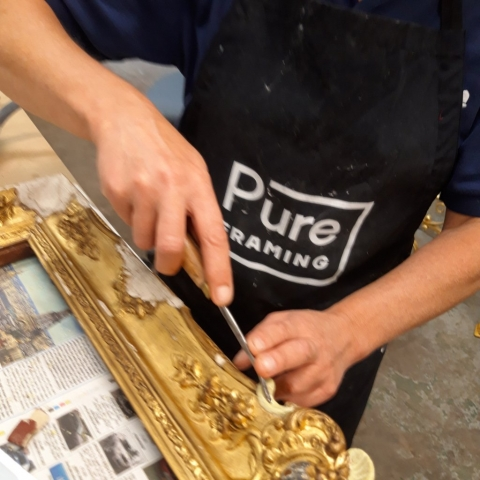 Jo working on a gilt frame restoration