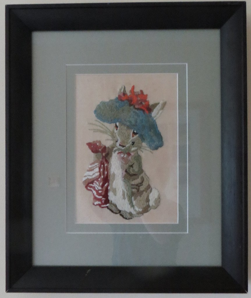 Needlepoint of a Beatrix Potter character in a double mount