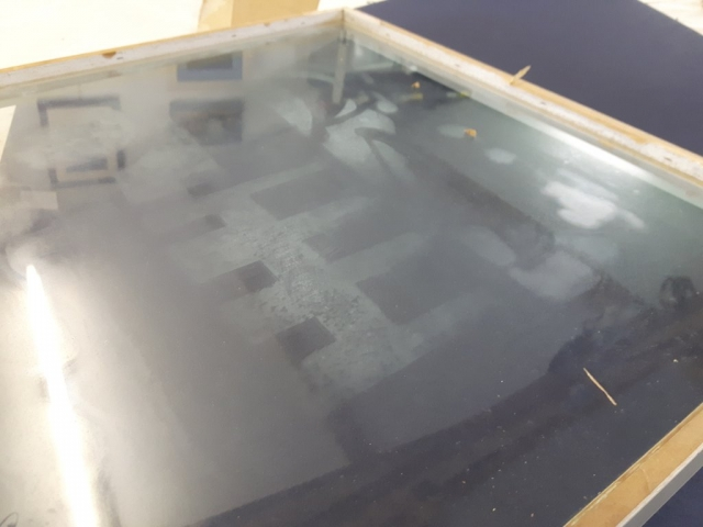 Repair and replacement glazing before cleaning showing the impression of the print